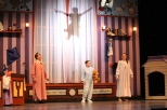 Sophomore Evan Stanfield, fourth-grader Griffin Scribner, and junior Sarah Denison watch as Peter pan flies about the room.