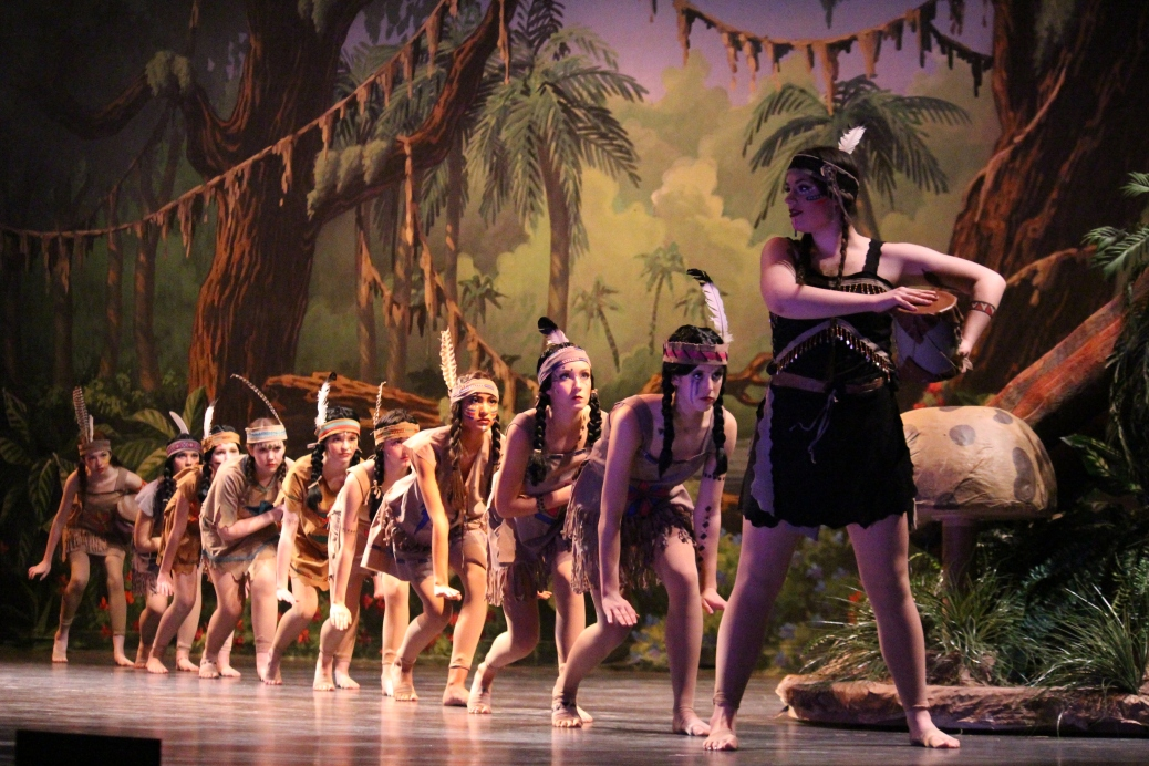 Sophomore Katelyn Carpenter as Tiger Lily leads her tribe through the woods of Neverland.