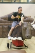Senior Logan Smith prepares to ride the mechanical bull at after-prom. Photo by Kaitlyn Erdman.