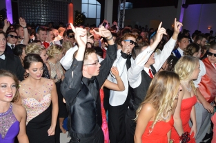 "Prom participants dance to the ""Cha-Cha Slide."" Photo by Sarah Strain."
