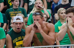Seniors Joe Sellers, Kendall Lafayette, and Jimmy Quenichet yell at passing by juniors. Photo by Robert Wormley