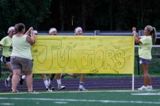 Juniors make their entrance onto the field. Photo by Nik Vellinger