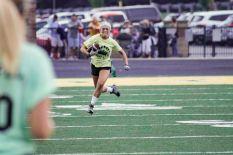 Junior Olivia Didat sprints down the sideline. Photo by Nik Vellinger