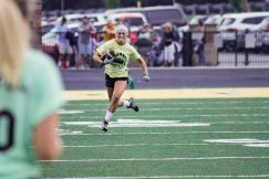 Junior Olivia Didat sprints down the sideline. Photo by Nik Vellinger