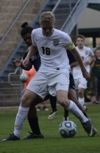 Senior Landon Campbell battles for the ball against a Collins High School defender.