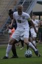 Senior Landon Campbell battles for the ball against a Collins High School defender.