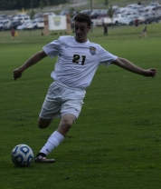 Sophomore Connor Burke shoots the ball during the first half.