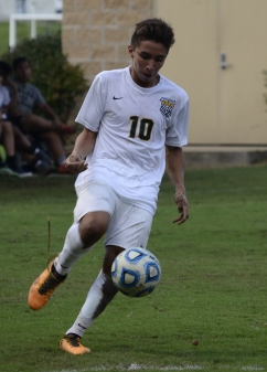 Junior Daniel Florez juggles the ball while moving down the field.