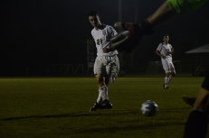 Sophomore Connor Burke takes a shot but is stopped by Collins goalkeeper Matthew Stoltz.