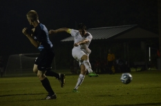 Senior Brodey Zink puts a shot on net in the second half.