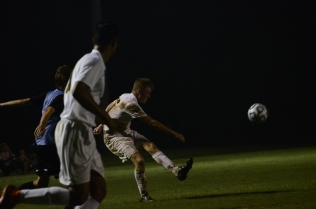 Senior Landon Campbell scores a goal in the second half putting the Highlanders up 2-1. The Titans scored late in the game to tie the game 2-2, and the game ended in a draw.