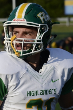 Senior Colt May looks up into the stands before the start of the game. Photo by Braden Schroeder