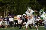 Junior Matthew Weimer hands the ball off to junior Devon Stikes. Photo by Braden Schroeder