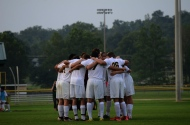 The boys' soccer team huddles before the start of the game against Martha Layne Collins High School on Aug. 18.