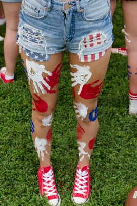 To show her support for FC and the USA, junior Hannah Schladant put red, white, and blue hand prints on her legs before the game.