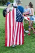 Wearing an American flag as a cape, senior Joe Sellers presents his pride for FC and USA.