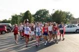 "The Kilt Krew marches their way into the stadium chanting ""USA""."