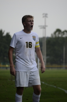 Senior Landon Campbell calls a play from the sideline before a corner kick.