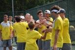 Freshman Adam Weiser gives the team high fives before the match begins.