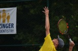 Senior Joseph Naville lines up his shot to send the ball flying back over the net to his opponent.