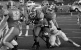 Columbus East senior Zach Springhorn drags down junior Jason Cundiff.