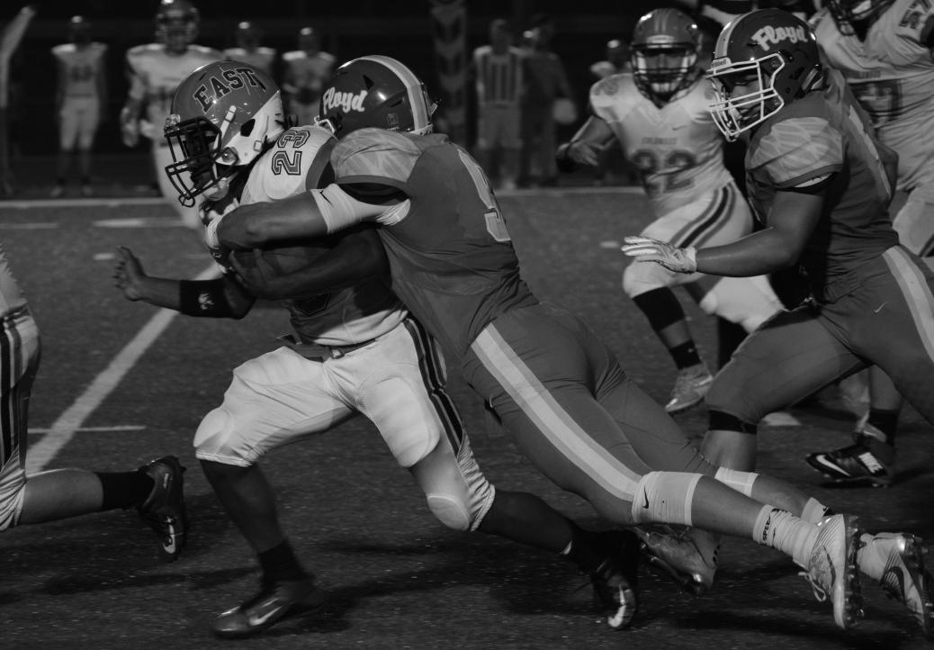 Junior Brandon Striegel tackles Columbus East junior Jamon Hogan.