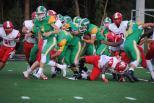 Jeffersonville junior Oscar Elliott grabs a hold of junior Jason Cundiff's waist to drag him to the ground.