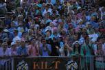 The Kilt Krew applauds the football team as they near the goal line.