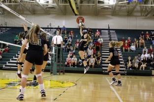 Senior Ashley Grider hits the ball over the net to the opposing team.
