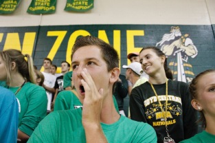 Senior Evan Saylor loudly cheers for his team during a timeout against New Albany.