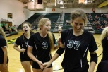Juniors Alexis Smith, Rachel Whitehouse and senior Ashley Grider celebrate after a timeout.