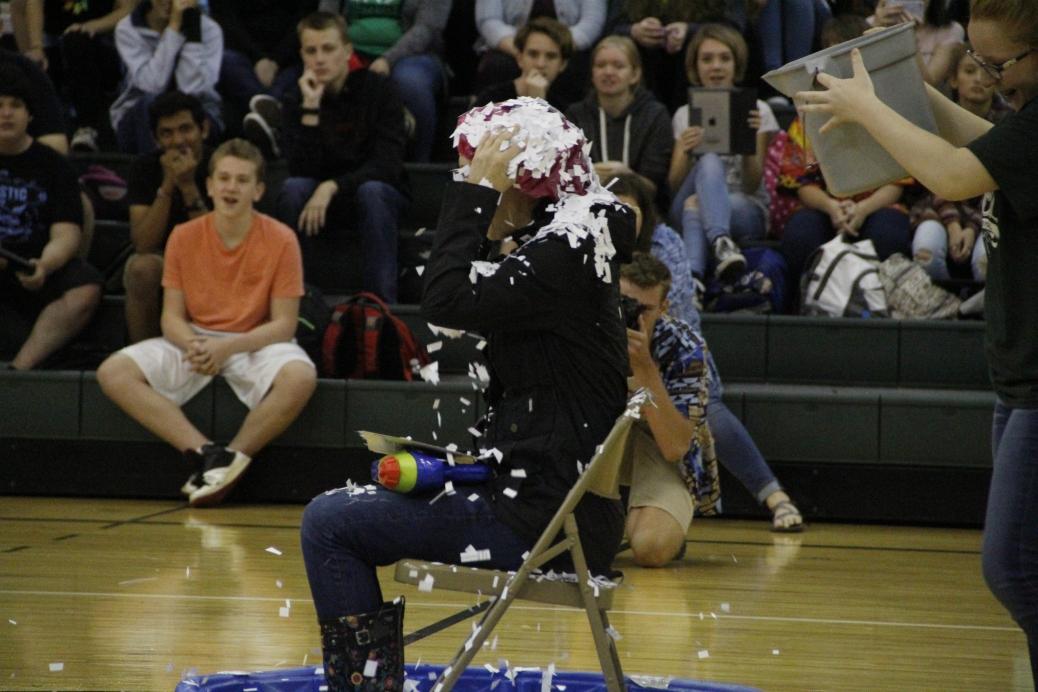 English teacher Karen Estus gets confetti dumped on her.