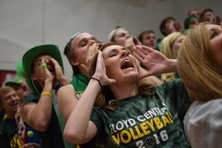 Senior Maci Korfhage chants with the student section.