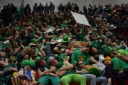"The Kilt Krew ""takes a nap"" during the announcement of New Albany's starting line-up."