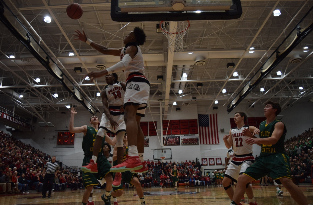 New Albany junior Romeo Langford blocks the shot of junior Brendon Hobson.