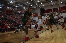 Sophomore Cobie Barnes is called for a charge on New Albany junior Romeo Langford.