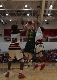 Junior Matthew Weimer puts up a shot over two New Albany defenders.