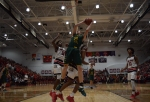 Senior Trevor Apple takes a shot underneath the basket.
