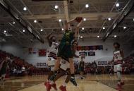 Senior Trevor Apple takes a shot underneath the basket.