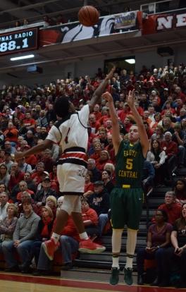 Senior Tyler Kimm shoots a three over New Albany junior Kobe Stanton.