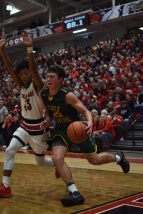 Junior Luke Gohmann drives past New Albany junior Savion Southers.