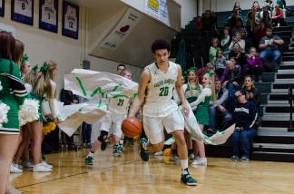 Sophomore Cobie Barnes leads the Highlanders out onto the court before the start of the game. Photo by Robert Wormley