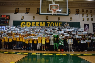 "The Green Zone is packed with students wearing gold and green for the ""Stripe the Stands"" theme during the FC-Providence game. Photo by Braden Schroeder"
