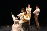 Sophomore Noah Hankins and juniors Evan Stanfield, Vivian Bulleit, Sam Moore, and Mitchell Lewis pose during the first song of the show.