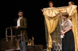 Junior Logan McNeeley and senior Emily Hardin interact on stage as seniors Gage Griffin and Aubrey Spencer hold up scenery.