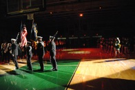 Members of ROTC leave the court after the band performs the nation anthem.