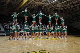 Cheerleaders hold each other up during the beginning of the rally.
