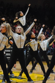Dazzlers dance in sync during their performance.