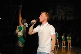Junior Jacob Rosenbaum leads the junior section in a chant.