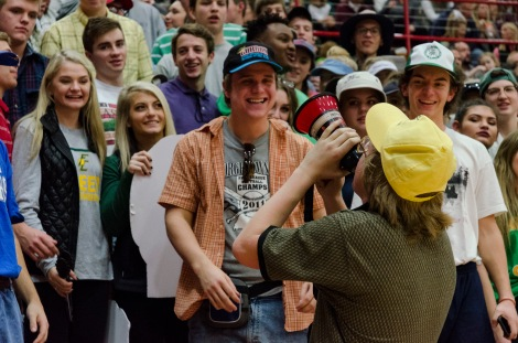 Senior Chandler Stumler leads a chant through his megaphone during a timeout. Photo by Robert Wormley.